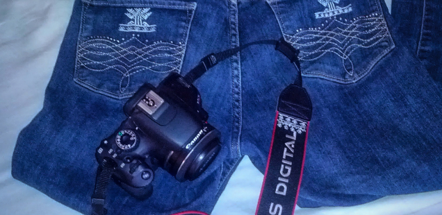 Custom embroidered jeans and camera strap by the Red Dao women
