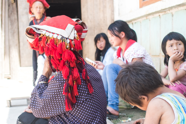 Red Dao woman's decorative red triangle turban