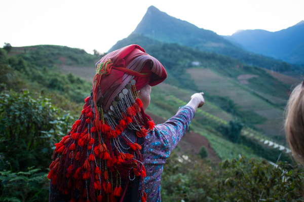 Red Dao woman along Buffalo Way at Topas Ecolodge in Sapa valley, Vietnam