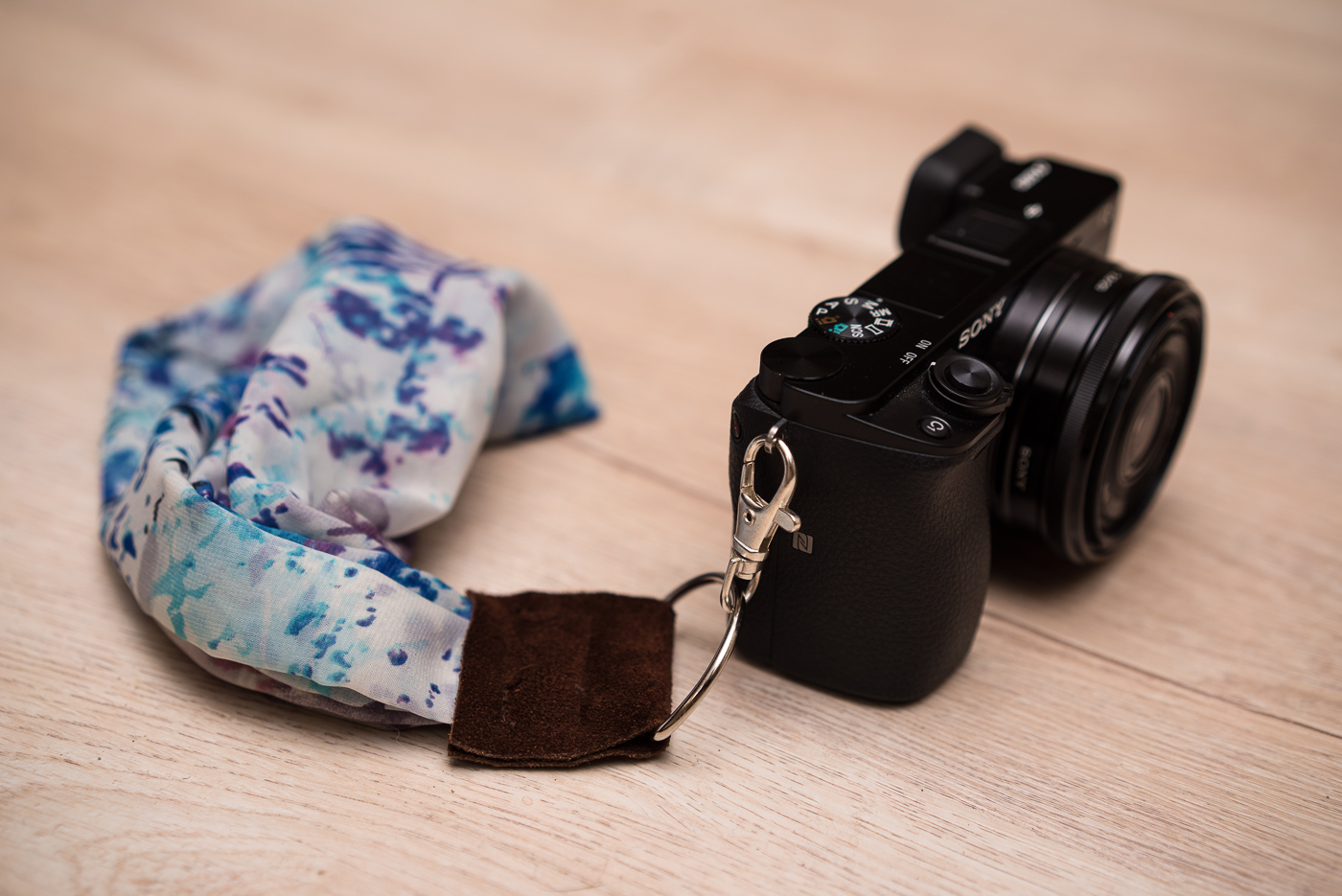 Glam up your camera with a pro quality diy silk scarf strap diy silk scarf camera wrist strap solutioingenieria Images