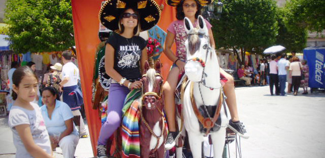 Cindy in Mexico on a fake horse