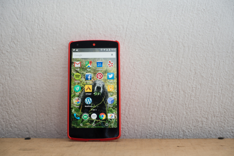 Red Nexus 5 smart phone with red case