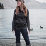 Cozy and Cute Camping Outfit on Stylish Travel Girl: Prana hat, North Face reversible vest, ICEWEAR top, GAP jeans, UGG Classic Cardy boots